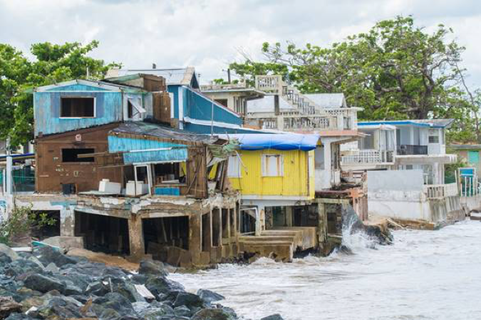 Photo of water hitting shoreline during hurricane