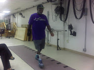 veteran male walking on new prosthetic leg